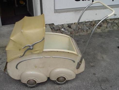 Color photograph of a fashionable, beige Swiss-made WWII baby stroller.