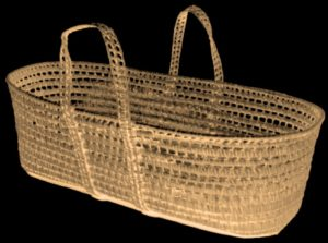 Image of a long oval wicker basket with looped carrying handles.