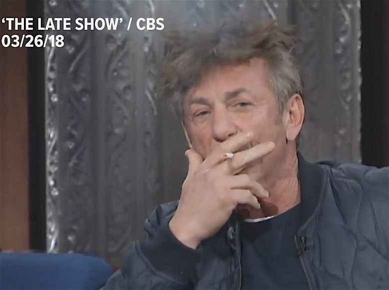 Promotional color photograph from CBS shows a frontal head and shoulders portrait of Sean Penn, ostensibly inhaling from a cigarette, with a haze above his head. Text superimposed over the image reads, The Late Show / CBS 03/26/18